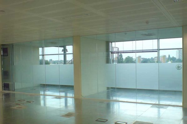 Glass partitions in office development