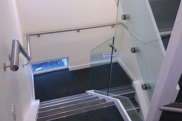 Glass balustrades on office staircase