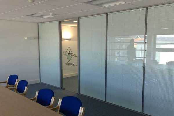 Glass partitions in meeting room