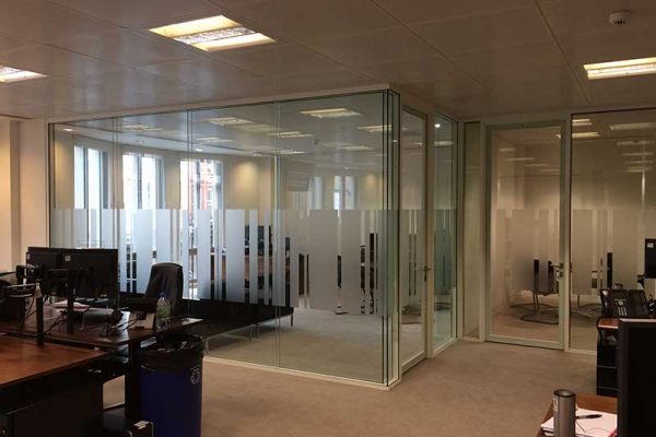 Glass partitions in office room