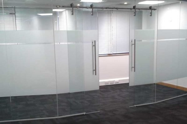 Glass partition with sliding doors