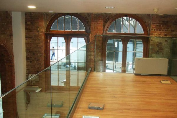 Frameless glass balustrading in modern office
