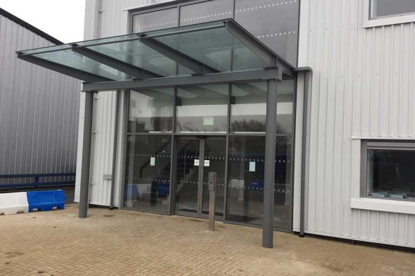 Glass canopy on commercial unit