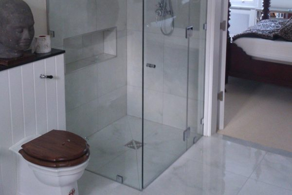 Frameless glass shower enclosure in residential property